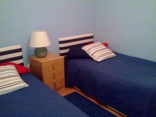 Quarto de duas ou três camas